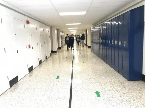 Early in the year, up to 35% of students attended on hybrid days. Around Thanksgiving break, though, a large number of hybrid students began staying home, leaving the hallways almost empty on some days.