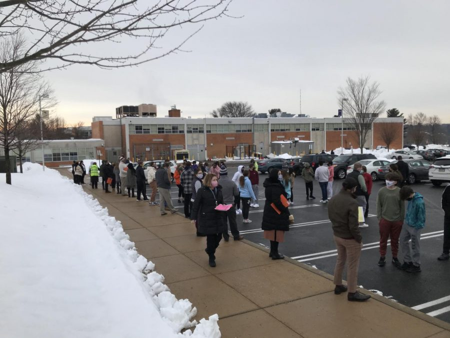 Teachers stand outside during a fire drill.