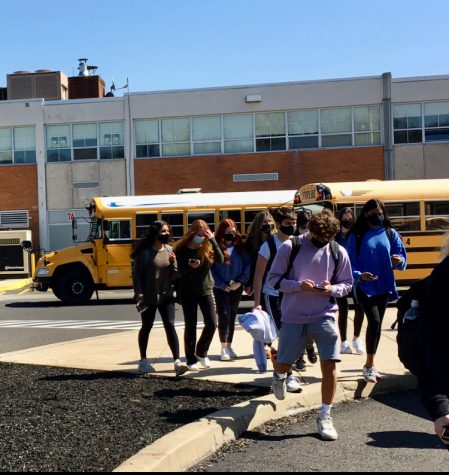 Juniors and seniors walk to their cars at the end of the school day.