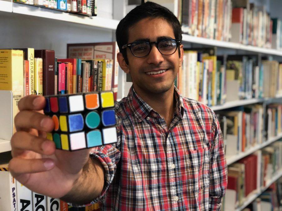 Manav Singh holds his trusty Rubik's cube. (Photo Credit: Mr. Engleman)